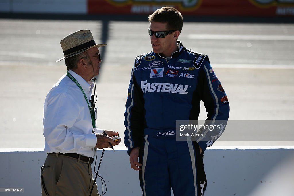 Team owner Jack Roush talks to Carl Edwards, driver of the #99 Fastenal Ford, during qualifying for the NASCAR Sprint Cup Series STP Gas Booster 500 on April 5, 2013 at Martinsville Speedway in Ridgeway, Virginia.