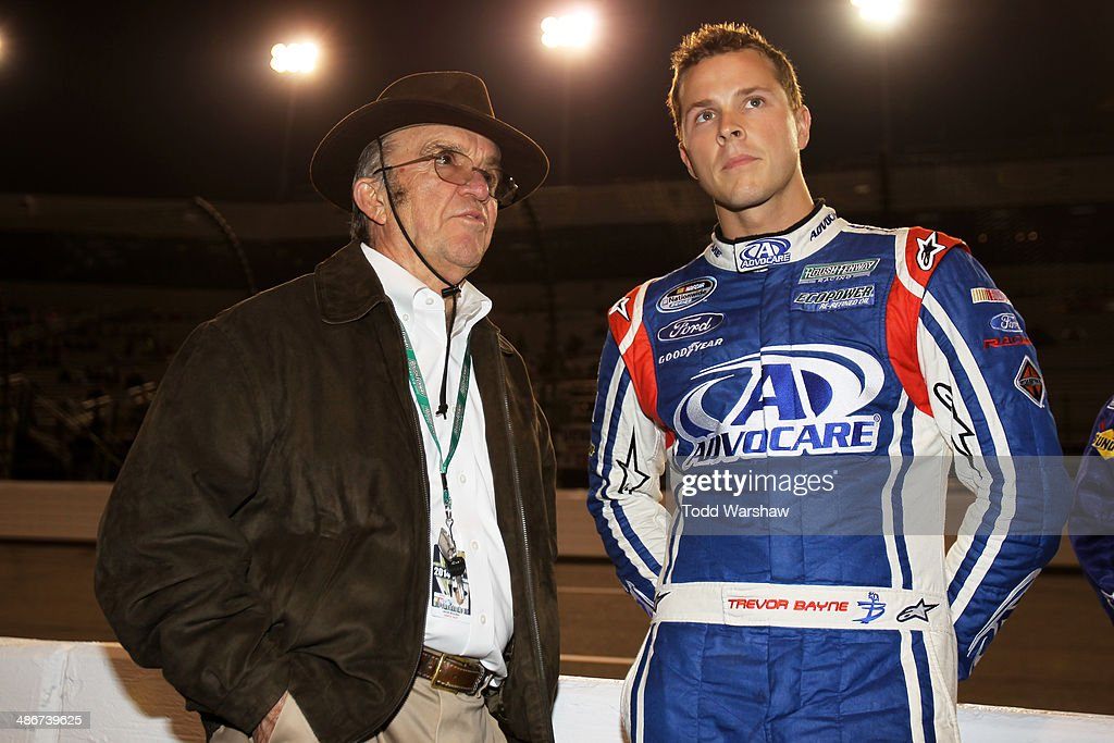 Team owner <a gi-track='captionPersonalityLinkClicked' href=/galleries/search?phrase=Jack+Roush&family=editorial&specificpeople=260209 ng-click='$event.stopPropagation()'>Jack Roush</a> talks to <a gi-track='captionPersonalityLinkClicked' href=/galleries/search?phrase=Trevor+Bayne&family=editorial&specificpeople=5533943 ng-click='$event.stopPropagation()'>Trevor Bayne</a>, driver of the #6 AdvoCare Ford, during pre-race ceremonies for the NASCAR Nationwide Series ToyotaCare 250 at Richmond International Raceway on April 25, 2014 in Richmond, Virginia.