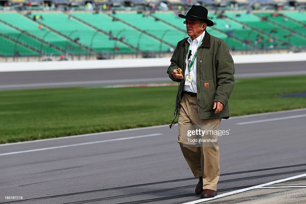 Team owner <a gi-track='captionPersonalityLinkClicked' href=/galleries/search?phrase=Jack+Roush&family=editorial&specificpeople=260209 ng-click='$event.stopPropagation()'>Jack Roush</a> walks on the grid during qualifying for the NASCAR Nationwide Series 13th Annual Kansas Lottery 300 at Kansas Speedway on October 5, 2013 in Kansas City, Kansas.