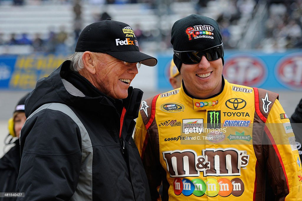 Team owner <a gi-track='captionPersonalityLinkClicked' href=/galleries/search?phrase=Joe+Gibbs&family=editorial&specificpeople=171526 ng-click='$event.stopPropagation()'>Joe Gibbs</a>, left, talks with <a gi-track='captionPersonalityLinkClicked' href=/galleries/search?phrase=Kyle+Busch&family=editorial&specificpeople=211123 ng-click='$event.stopPropagation()'>Kyle Busch</a>, driver of the #18 M&M's Toyota, during pre-race ceremonies for the NASCAR Sprint Cup Series STP 500 at Martinsville Speedway on March 30, 2014 in Martinsville, Virginia.