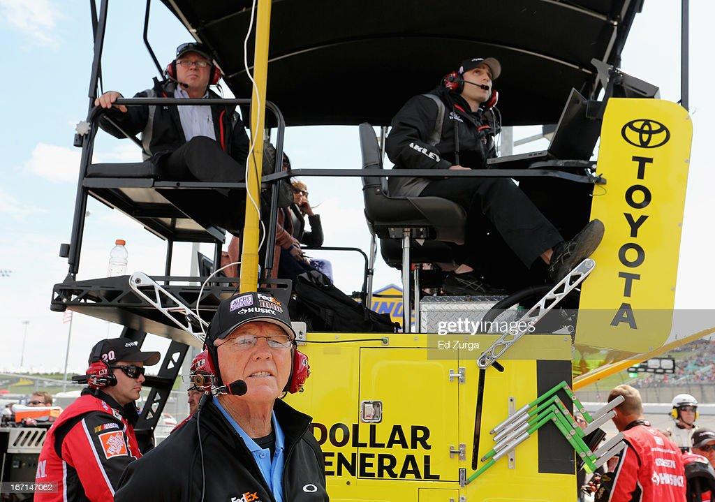 Team owner Joe Gibbs looks on as Matt Kenseth, driver of the #20 The Home Depot/Husky Toyota, races to win the NASCAR Sprint Cup Series STP 400 at Kansas Speedway on April 21, 2013 in Kansas City, Kansas.