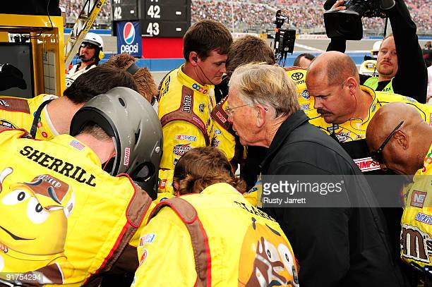 Team Owner Joe Gibbs of the MM's Toyota prays with team members prior to the start of the NASCAR Sprint Cup Series Pepsi 500 at Auto Club Speedway on...