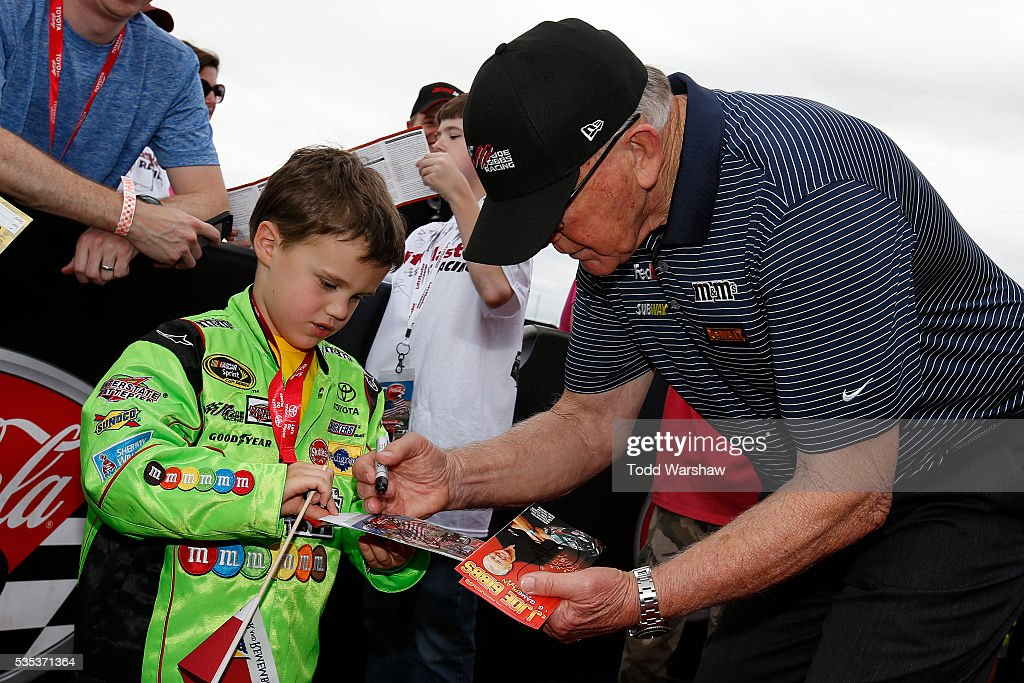 Team owner <a gi-track='captionPersonalityLinkClicked' href=/galleries/search?phrase=Joe+Gibbs&family=editorial&specificpeople=171526 ng-click='$event.stopPropagation()'>Joe Gibbs</a> signs autographs for fans at the driver's meeting prior to the NASCAR Sprint Cup Series Coca-Cola 600 at Charlotte Motor Speedway on May 29, 2016 in Charlotte, North Carolina.