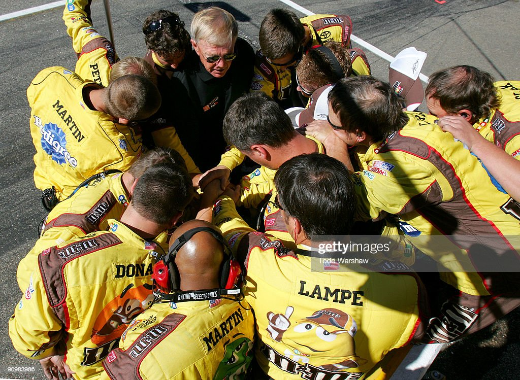 Team owner <a gi-track='captionPersonalityLinkClicked' href=/galleries/search?phrase=Joe+Gibbs&family=editorial&specificpeople=171526 ng-click='$event.stopPropagation()'>Joe Gibbs</a> (black shirt) talks with the #18 M&M's crew before the NASCAR Sprint Cup Series Sylvania 300 at the New Hampshire Motor Speedway on September 20, 2009 in Loudon, New Hampshire.