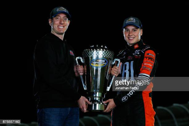 Team owner Kyle Busch and Christopher Bell driver of the JBL Toyota poses with the trophy after winning the Camping World Truck Series Championship...