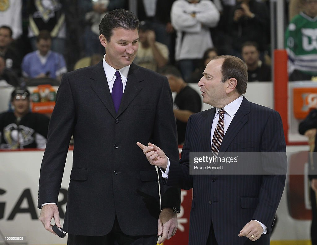 Team owner <a gi-track='captionPersonalityLinkClicked' href=/galleries/search?phrase=Mario+Lemieux&family=editorial&specificpeople=201640 ng-click='$event.stopPropagation()'>Mario Lemieux</a> of the Pittsburgh Penguins and NHL commissioner <a gi-track='captionPersonalityLinkClicked' href=/galleries/search?phrase=Gary+Bettman&family=editorial&specificpeople=215089 ng-click='$event.stopPropagation()'>Gary Bettman</a> arrive for the opening faceoff between the Penguins and the Philadelphia Flyers at the Consol Energy Center on October 7, 2010 in Pittsburgh, Pennsylvania.