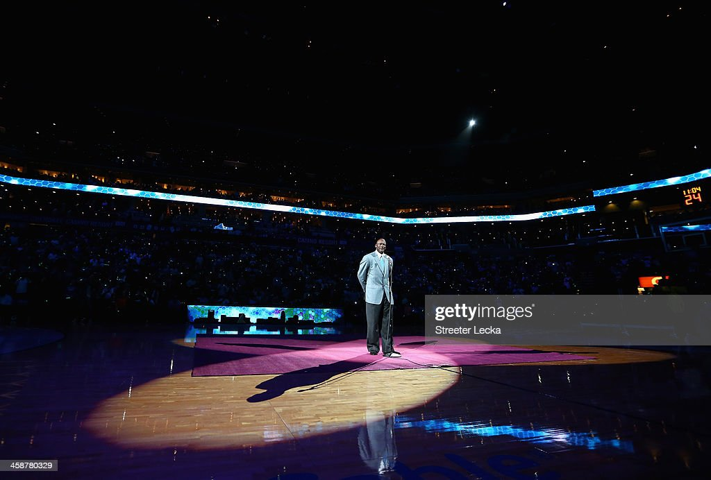 Team owner, Michael Jordan, of the Charlotte Bobcats unveils the new logo for next years name change during their game at Time Warner Cable Arena on December 21, 2013 in Charlotte, North Carolina.