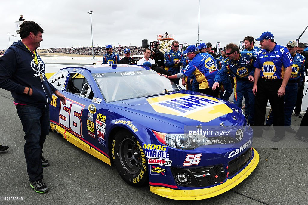 Team Owner Michael Waltrip celebrates with Martin Truex Jr driver of the NAPA Auto Parts Toyota after winning the NASCAR Sprint Cup Series...