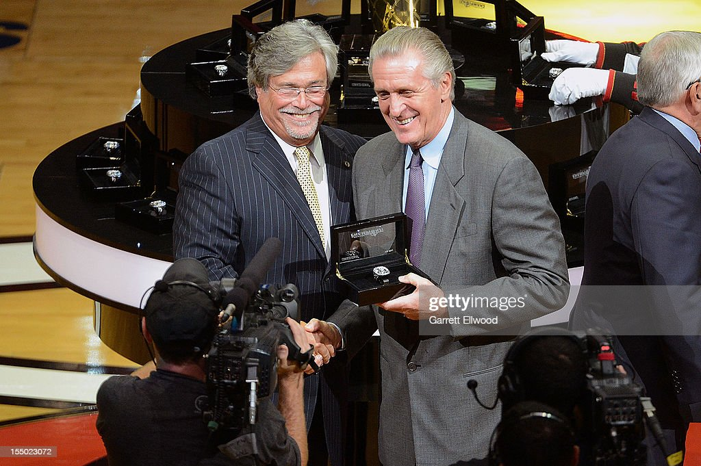 Team Owner Mickey Arinson presents President Pat Riley of the Miami Heat with a 2012 NBA Championship ring prior to the game against the Boston Celtics on October 30, 2012 at American Airlines Arena in Miami, Florida.