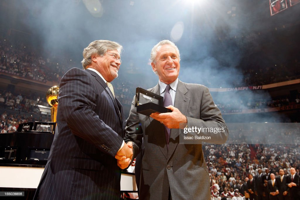 Team Owner Mickey Arison presents President Pat Riley of the Miami Heat with a 2012 NBA Championship ring during a ceremony prior to the NBA game on October 30, 2012 at American Airlines Arena in Miami, Florida.