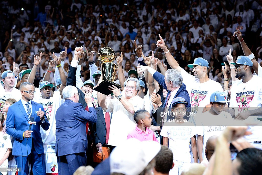 Team owner Micky Arison of the Miami Heat holds up the Larry O'Brien Championship trophy as he celebrates with his players after they won 121-106 against the Oklahoma City Thunder in Game Five of the 2012 NBA Finals on June 21, 2012 at American Airlines Arena in Miami, Florida.