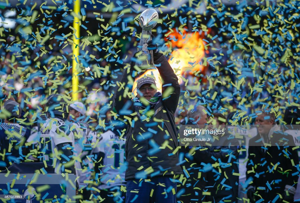 Team Owner Paul Allen of the Seattle Seahawks holds the Lombardi Trophy during ceremonies following the Super Bowl XLVIII Victory Parade at CenturyLink Field on February 5, 2014 in Seattle, Washington.