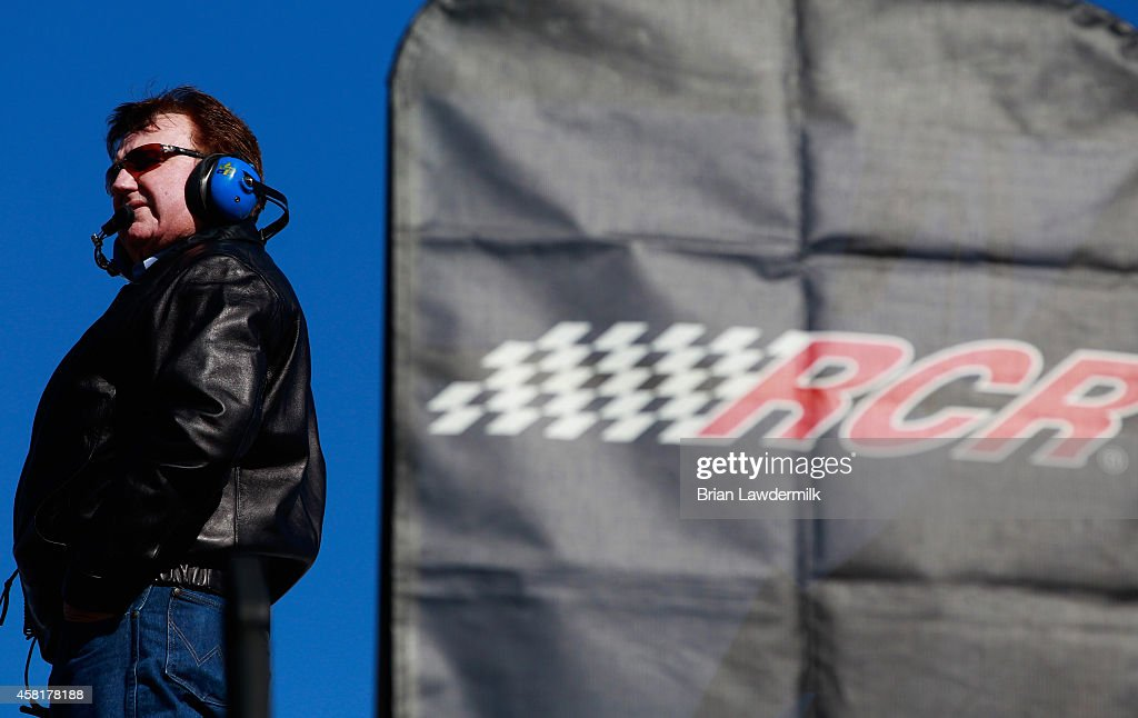 Team owner Richard Childress looks on from on top of a hauler during practice for the NASCAR Nationwide Series O'Reilly Auto Parts Challenge at Texas...