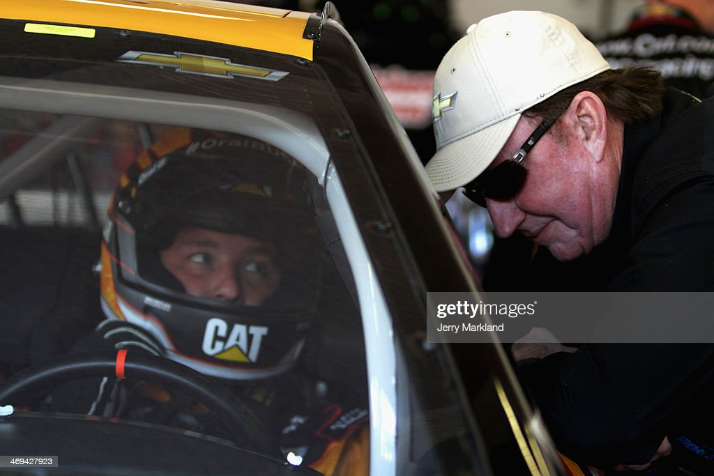 Team owner Richard Childress speaks with Ryan Newman driver of the Caterpillar Chevrolet in the garage area during practice for the NASCAR Sprint Cup...