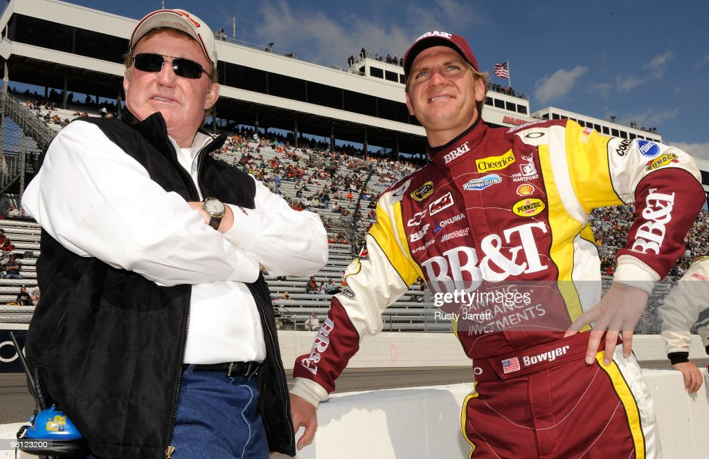 Team owner Richard Childress stands with Clint Bowyer driver of the BBT Chevrolet on the grid prior to the NASCAR Sprint Cup Series Goody's Fast Pain...