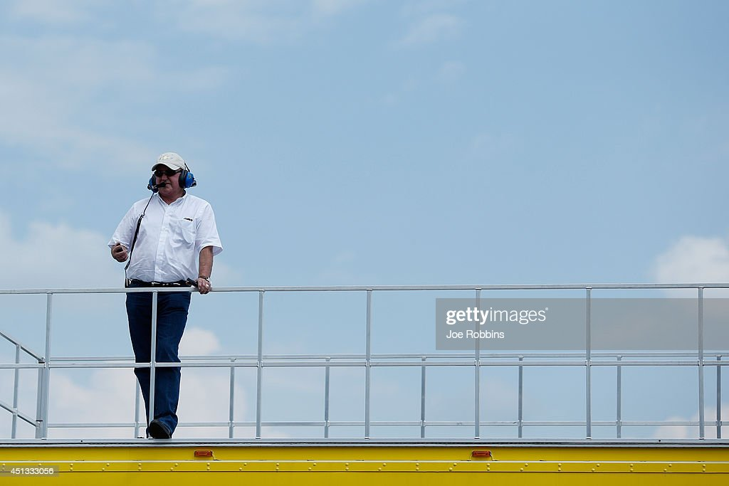 Team owner Richard Childress watches from the top of a car transporter during practice for the NASCAR Sprint Cup Series Quaker State 400 presented by...