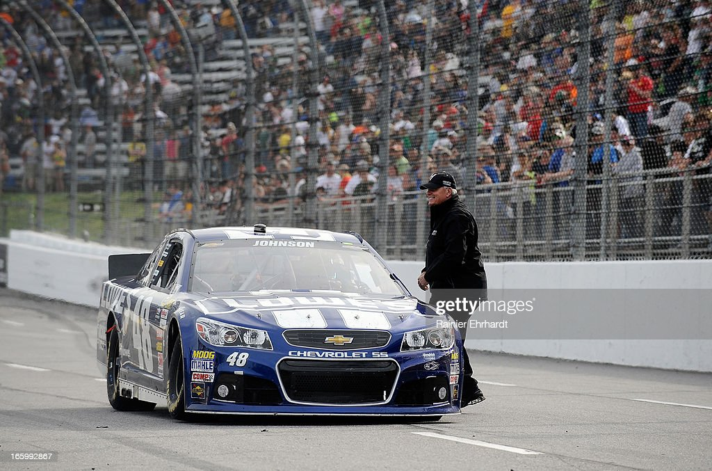 Team owner Rick Hendrick celebrates with Jimmie Johnson, driver of the #48 Lowe's Chevrolet, after winning the NASCAR Sprint Cup Series STP Gas Booster 500 on April 7, 2013 at Martinsville Speedway in Ridgeway, Virginia.