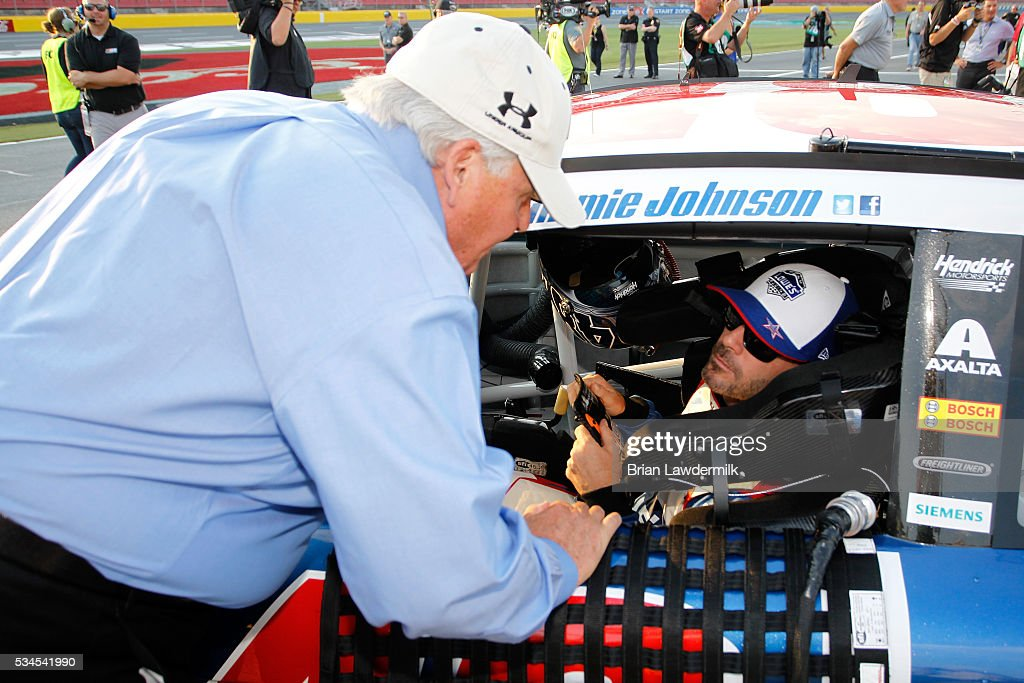 Team owner <a gi-track='captionPersonalityLinkClicked' href=/galleries/search?phrase=Rick+Hendrick&family=editorial&specificpeople=596436 ng-click='$event.stopPropagation()'>Rick Hendrick</a> speaks with <a gi-track='captionPersonalityLinkClicked' href=/galleries/search?phrase=Jimmie+Johnson+-+Nascar+Race+Driver&family=editorial&specificpeople=171519 ng-click='$event.stopPropagation()'>Jimmie Johnson</a>, driver of the #48 Lowe's Patriotic Chevrolet, during qualifying for the NASCAR Sprint Cup Series Coca-Cola 600 at Charlotte Motor Speedway on May 27, 2016 in Charlotte, North Carolina.