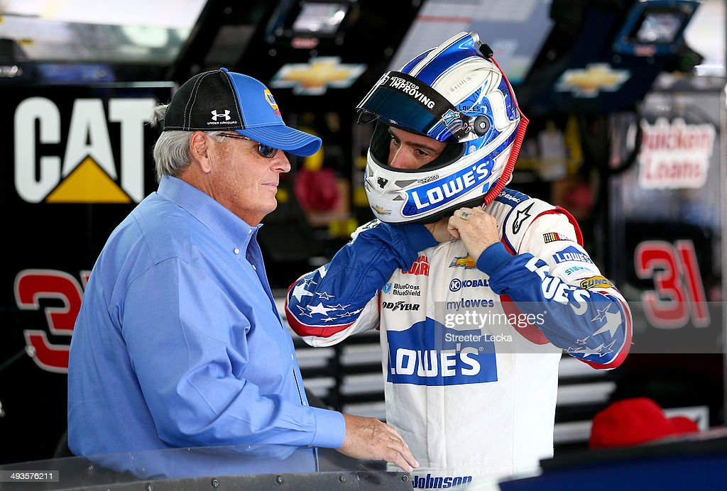 Team owner Rick Hendrick (L) talks to Jimmie Johnson, driver of the #48 Lowe's Patriotic Chevrolet, in the garage area during practice for the NASCAR Sprint Cup Series Coca-Cola 600 at Charlotte Motor Speedway on May 24, 2014 in Charlotte, North Carolina.
