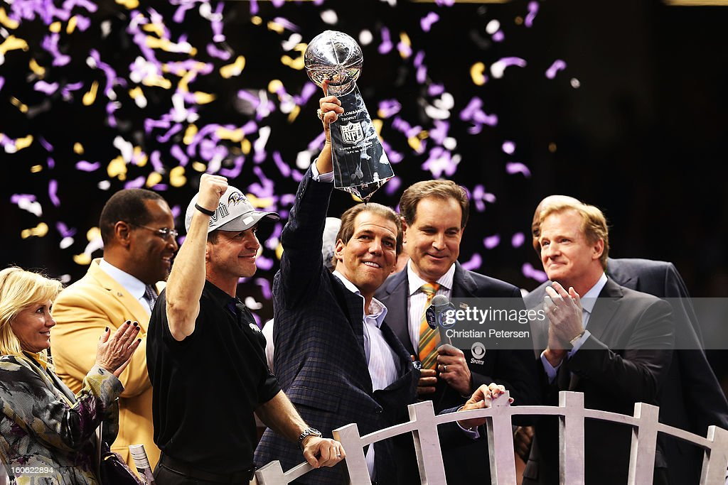 Team owner <a gi-track='captionPersonalityLinkClicked' href=/galleries/search?phrase=Steve+Bisciotti&family=editorial&specificpeople=3079316 ng-click='$event.stopPropagation()'>Steve Bisciotti</a> of the Baltimore Ravens holds up the Vince Lombardi trophy as he celebrates with head coach <a gi-track='captionPersonalityLinkClicked' href=/galleries/search?phrase=John+Harbaugh&family=editorial&specificpeople=763525 ng-click='$event.stopPropagation()'>John Harbaugh</a> (L of Bisciotti) after they won 34-31 against the San Francisco 49ers during Super Bowl XLVII at the Mercedes-Benz Superdome on February 3, 2013 in New Orleans, Louisiana.