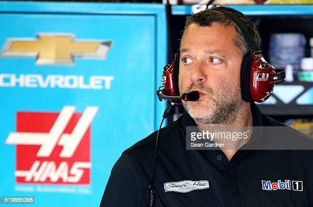 Team owner Tony Stewart stands in the garage area during practice for the NASCAR Sprint Cup Series Duck Commander 500 at Texas Motor Speedway on...