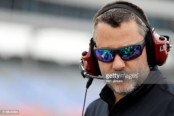 Team owner Tony Stewart stands on the grid during qualifying for the NASCAR Sprint Cup Series Duck Commander 500 at Texas Motor Speedway on April 8...