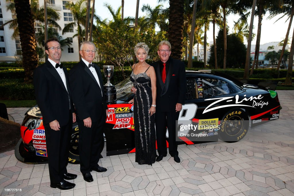 Team owners J.D. Gibbs and Joe Gibbs poses next to the #18 Toyota, prior to the NASCAR Nationwide Series And Camping World Truck Awards Banquet at Loews Miami Beach on November 19, 2012 in Miami Beach, Florida.