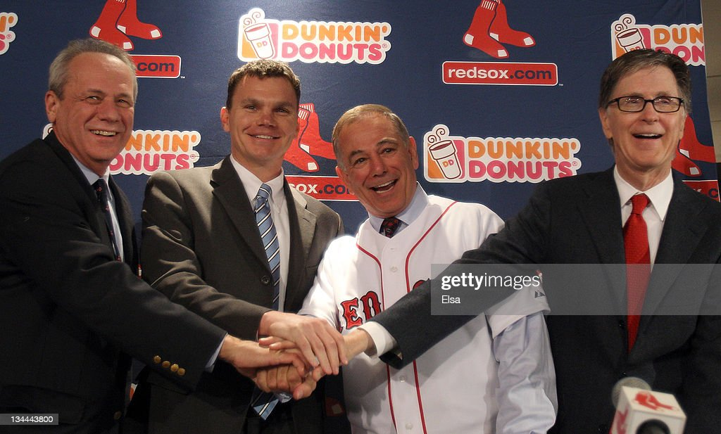 Team owners Larry Lucchino, left, and John Henry, far right, and vice president and general manager Ben Cherington, center, pose with Bobby Valentine after he was introduced as the new manager for the Boston Red Sox during a press conference on December 1, 2011 at Fenway Park in Boston, Massachusetts.