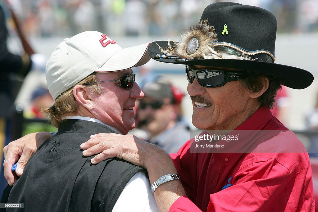 Team owners Richard Childress and Richard Petty hug on the grid prior to the start of the NASCAR Sprint Cup Series Autism Speaks 400 at Dover...