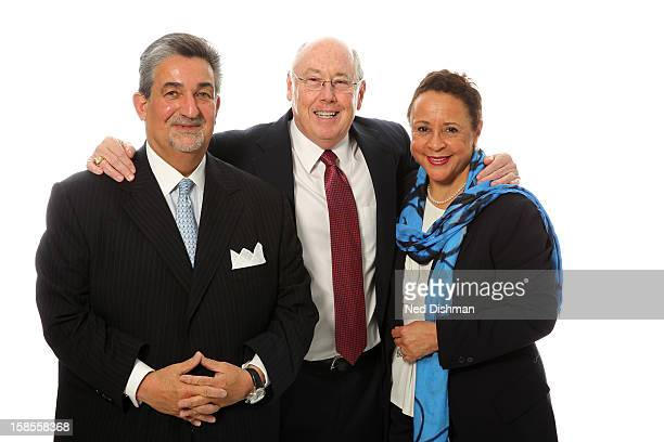 Team Owners Ted Leonsis and Sheila Johnson stand with new Head Coach Mike Thibault of the Washington Mystics as they pose for a photo before a press...