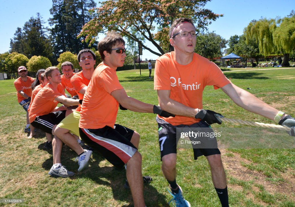 Team Palantir participates in the Tug-a-Rope competition during the Founder Institute's Silicon Valley Sports League event on July 13, 2013 in Palo Alto, California.