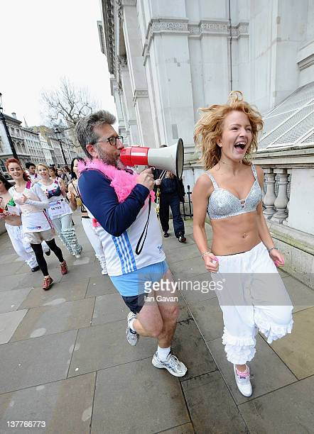 Team PB runners and Neil Fox exercise on Whitehall during the Team Pants And Bra photcall at Westminster on January 26 2012 in London England Team...