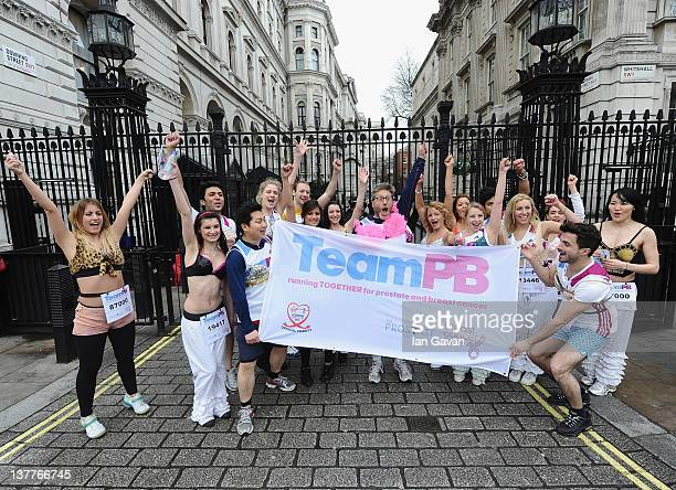 Team PB runners and Neil Fox exercise outside the Downing Street during the Team Pants And Bra photcall at Westminster on January 26 2012 in London...