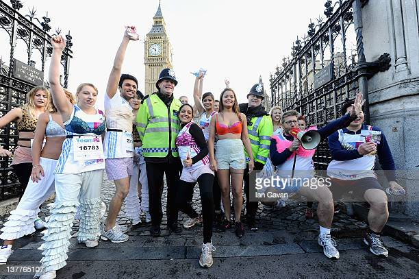 Team PB runners and Neil Fox exercise outside the Houses of Parliment during the Team Pants And Bra photcall at Westminster on January 26 2012 in...