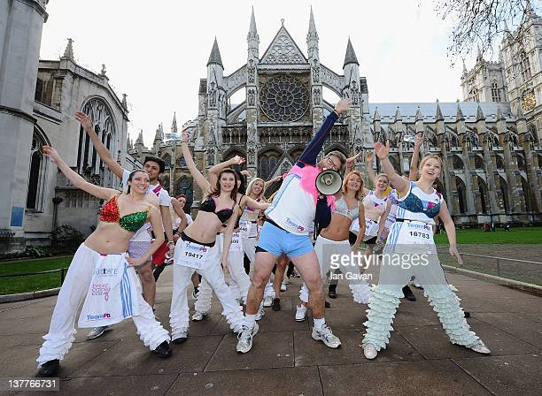 Team PB runners and Neil Fox exercise outside the Westminster Abbey during the Team Pants And Bra photcall at Westminster on January 26 2012 in...