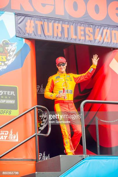 Team Penske Shell Pennzoil Ford driver Joey Logano waves to the fans during the Monster Energy Cup Series Tale of the Turtles 400 driver...