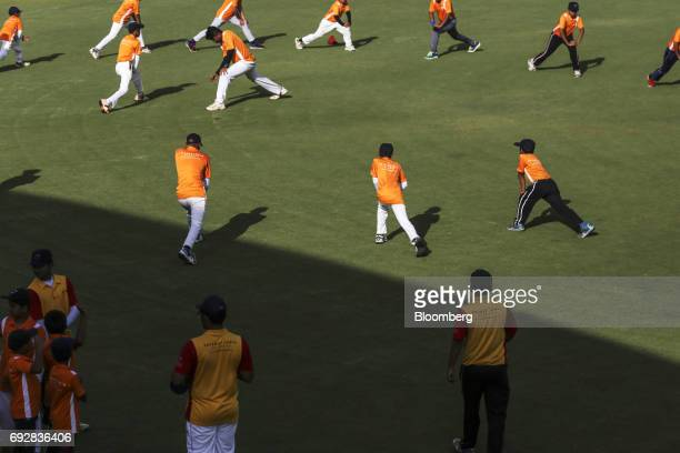 A team perform warmup exercises at a cricket stadium in Palava City on the outskirts of Mumbai India on Thursday May 25 2017 Lodha Group best known...