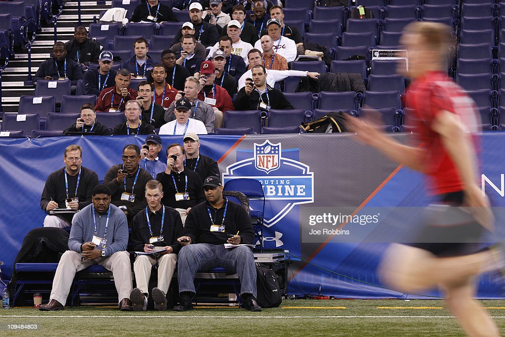 Team personnel record times in the 40yard dash during the 2011 NFL Scouting Combine at Lucas Oil Stadium on February 27 2011 in Indianapolis Indiana