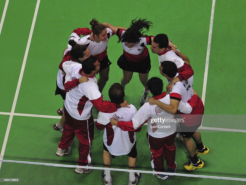 Team Peru celebrate after the victory of Daniela Macias to win the tournament in the Badminton Mixed Team's event as part of the XVII Bolivarian Games Trujillo 2013 at Coliseo Miguel Grau on November 18, 2013 in Lima, Peru.