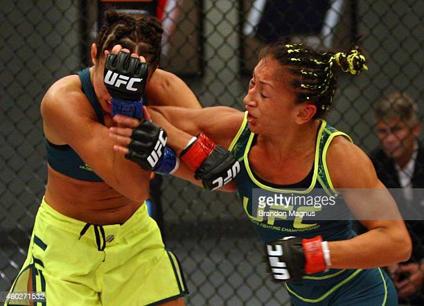 Team Pettis fighter Carla Esparza elbows team Pettis fighter Jessica Penne during filming of season twenty of The Ultimate Fighter on August 14 2014...
