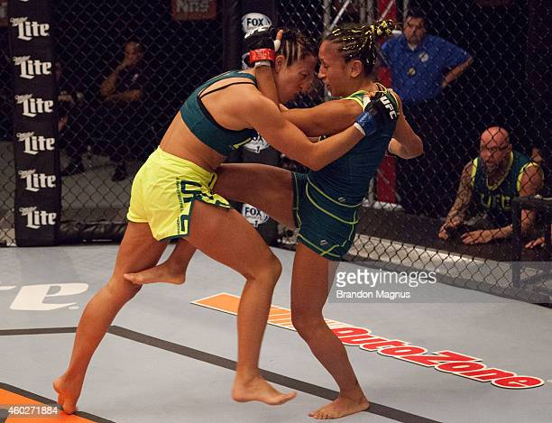 Team Pettis fighter Carla Esparza knees team Pettis fighter Jessica Penne during filming of season twenty of The Ultimate Fighter on August 14 2014...