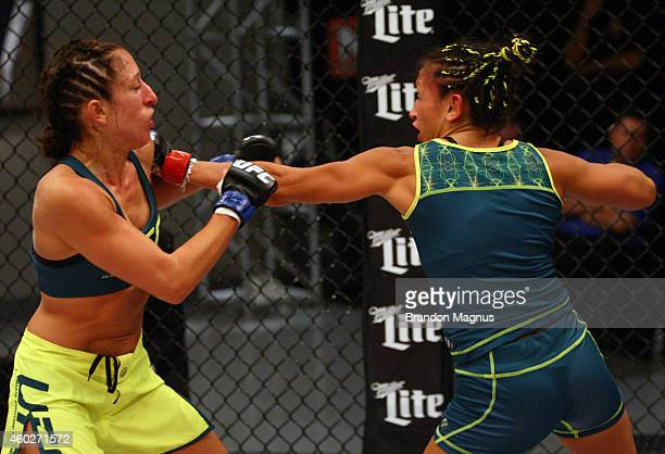 Team Pettis fighter Carla Esparza punches team Pettis fighter Jessica Penne during filming of season twenty of The Ultimate Fighter on August 14 2014...