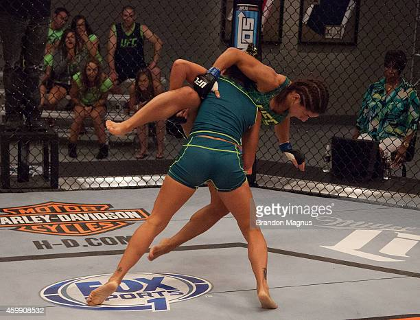 Team Pettis fighter Carla Esparza takes down team Pettis fighter Tecia Torres in the quarterfinals during filming of season twenty of The Ultimate...