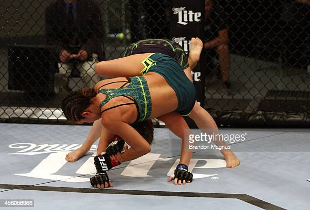 Team Pettis fighter Jessica Penne controls the body of team Melendez fighter Lisa Ellis during filming of season twenty of The Ultimate Fighter on...