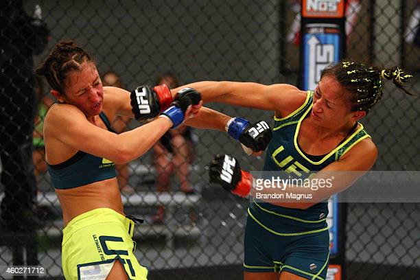 Team Pettis fighter Jessica Penne exchanges punches with team Pettis fighter Carla Esparza during filming of season twenty of The Ultimate Fighter on...