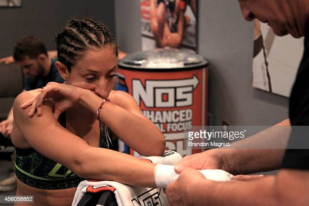 Team Pettis fighter Jessica Penne gets her hands wrapped before facing team Melendez fighter Lisa Ellis during filming of season twenty of The...