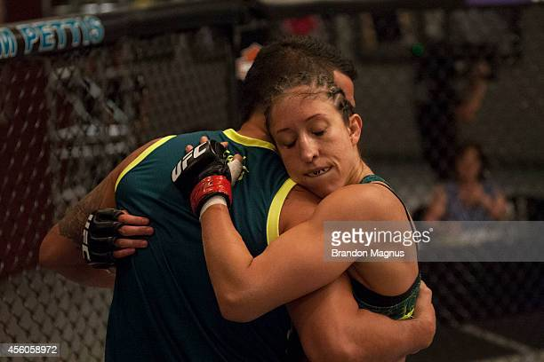 Team Pettis fighter Jessica Penne hugs Head Coach Anthony Pettis after defeating team Melendez fighter Lisa Ellis during filming of season twenty of...