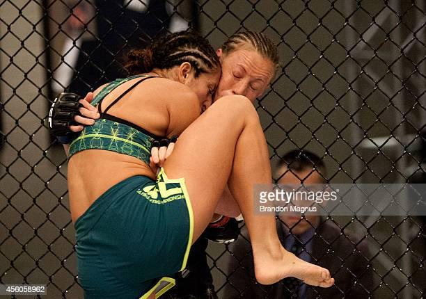 Team Pettis fighter Jessica Penne knees team Melendez fighter Lisa Ellis during filming of season twenty of The Ultimate Fighter on July 15 2014 in...