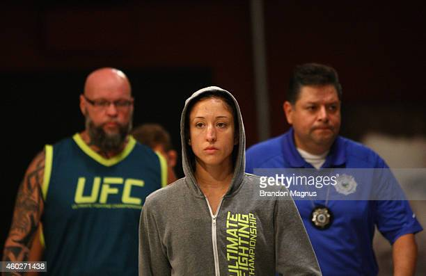 Team Pettis fighter Jessica Penne prepares to enter the octagon before facing team Pettis fighter Carla Esparza during filming of season twenty of...