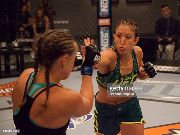 Team Pettis fighter Jessica Penne punches team Melendez fighter Lisa Ellis during filming of season twenty of The Ultimate Fighter on July 15 2014 in...